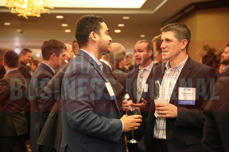 Khristian Gutierrez of Passport and Daniel McCollum of Torrent Consulting network during the Fast 50 reception.