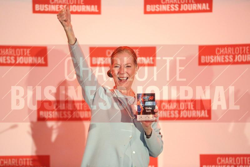 Hissho Sushi accepts their #37 award.