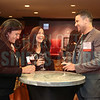 AccruePartners team members enjoy drinks at the Fast 50 reception.