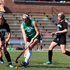 Oakmont player Christina Lengieza, in black, chases after Nashoba player Hannah Gaffney during action in their game at Doyle Field on Tuesday afternoon. SENTINEL & ENTERPRISE/JOHN LOVE