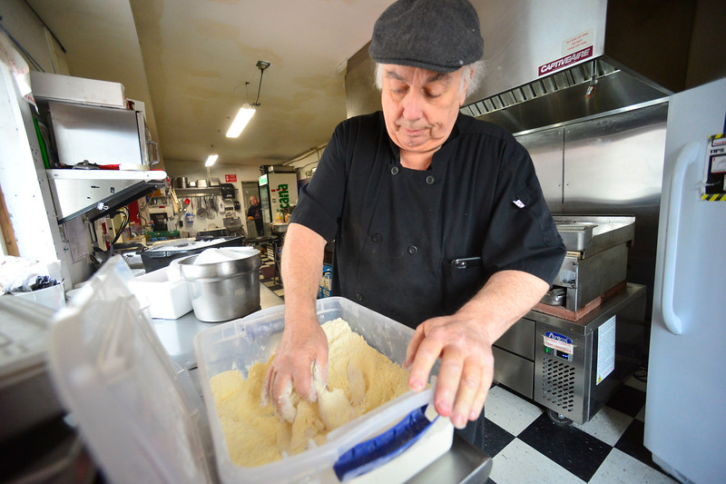 KRISTOPHER RADDER — BRATTLEBORO REFORMER<br /> Eddie Cagliano, owner of Fast Eddies, on Putney Road, in Brattleboro, makes fish fry on Friday, Feb. 28, 2020.
