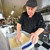 KRISTOPHER RADDER — BRATTLEBORO REFORMER<br /> Eddie Cagliano, owner of Fast Eddies, on Putney Road, in Brattleboro, makes fish fry on Friday, Feb. 28, 2020.