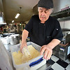 KRISTOPHER RADDER — BRATTLEBORO REFORMER<br /> Eddie Cagliano, owner of Fast Eddies, on Putney Road, in Brattleboro, beards the haddock with his special recipe before putting it into the fryer on Friday, Feb. 28, 2020.