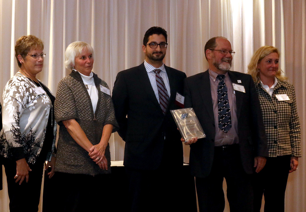 . Jonathan Tressler � The News-Herald <br> Representatives of the Holden Arboretum in Kirtland pause for a photo with awards presenter Peter Zahirsky, center, of the Lake County Ohio Port and Economic Development Authority, during the 2016 Lake-Geauga Fast Track 50 awards dinner on Nov. 3. Holden Arboretum received the 2016 Fast Track 50 Game Changer Award.