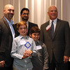 Jonathan Tressler — The News-Herald <br> Dr. Jorge Garcia-Zuazaga, left, poses for a photo with his sons, Nicholas Garcia, left and Lucka Garcia, along with Peter Zahirsky and Timothy Cahill of the Lake County Ohio Port and Economic Development Authority at the Nov. 3 Lake-Geauga Fast Track 50 awards dinner. Garcia-Zuazaga is founder of Apex Dermatology of Concord Township, which received the 2016 Fast Track 50 Entrepreneur of the Year Award.