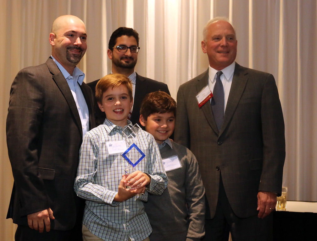 . Jonathan Tressler � The News-Herald <br> Dr. Jorge Garcia-Zuazaga, left, poses for a photo with his sons, Nicholas Garcia, left and Lucka Garcia, along with Peter Zahirsky and Timothy Cahill of the Lake County Ohio Port and Economic Development Authority at the Nov. 3 Lake-Geauga Fast Track 50 awards dinner. Garcia-Zuazaga is founder of Apex Dermatology of Concord Township, which received the 2016 Fast Track 50 Entrepreneur of the Year Award.