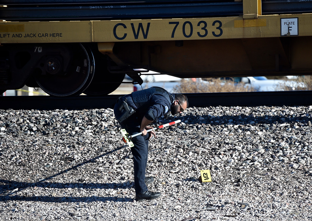 . LONGMONT, CO - FEBRUARY 3, 2019: Emergency crews investigate a fatal train versus bicyclist accident at the intersection of Ken Pratt Boulevard and Nelson Road on Sunday in Longmont. For more photos of the scene go to timescall.com (Photo by Jeremy Papasso/Staff Photographer)