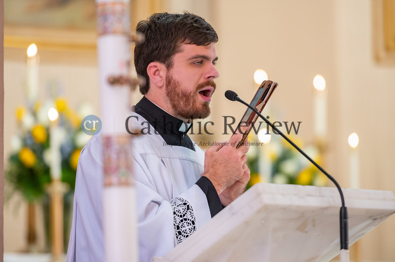 Peter Myers, a seminarian at St. Mary's Seminary in Baltimore, who is legally blind, reads scripture from a Kindle during the priestly ordination of Father Scott Kady June 19, 2021 at his home parish, St. Peter Catholic Church in Westernport, Allegany County. (Kevin J. Parks/CR Staff)