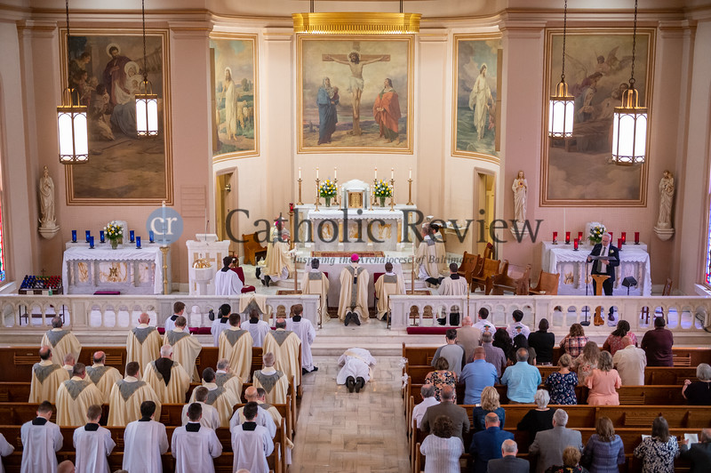 Father Scott Kady prostrates in front of the altar during the Litany of Supplication at his ordination to the priesthood June 19, 2021 at his home parish of St. Peter Catholic Church in Westernport, Allegany County. (Kevin J. Parks/CR Staff)