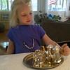 Kenna enjoyed using L-ma's fancy miniature tea set!