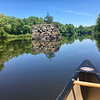 A canoe approached the remains of the old Middlesex Canal in the Concord River in Billerica. Photo by Mary Leach