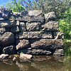 A stone abutment still stands to remind rowers what used to be a canal that passed over the Concord River in Billerica. Photo by Mary Leach