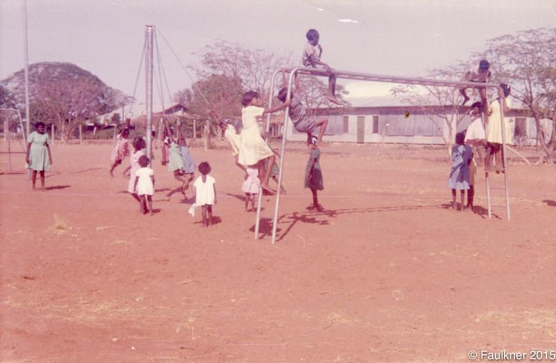 Children playing on new playgorund equipment