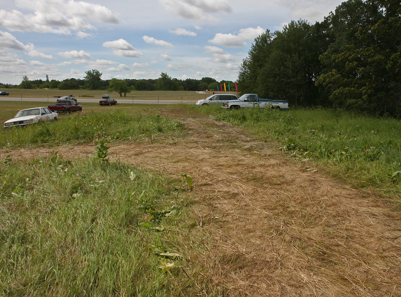 Bird's Hill Park, Manitoba (2007): The milkweed patch, destroyed during  the festival in 2007. In subsequent years, the area has been successfully protected by installing security tape and instituting a parking ban.