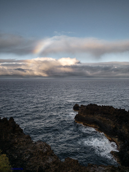 Rainbow over the Volcanic Coast