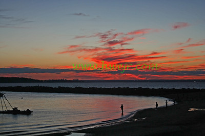 """Fishermen tapping the last light while NYC is just visible in the background - north shore Long Island , NY. The foto can be found in its original category """" Travel - NY """"  in the gallery  """" New York  Sept, 2005 """" as image #0220"""