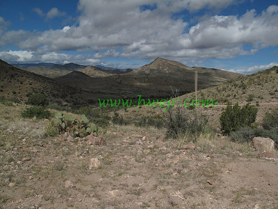 "A whole lot of sparsely populated foothills in the desert describes this section of New Mexico. This foto can be found in its original category "" Travel - NM ""  in the gallery  "" New Mexico Oct, 2009 -2 "" as image #2146"