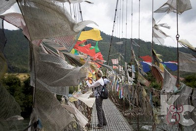 Placing Prayer Flags on Bridge