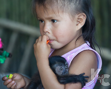 Ribiñero Child With Pet Monkey