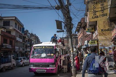 Street Scene With Crowded Bus in Patan
