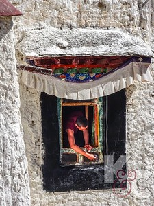 Monk Cleaning Paint off Window at Drepung Monastery