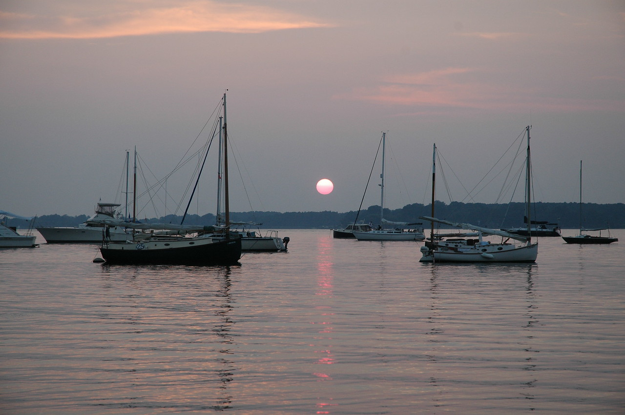 7/29/2006 - Sun setting at Conquest Beach MD during the Corsica River Annual Regatta.