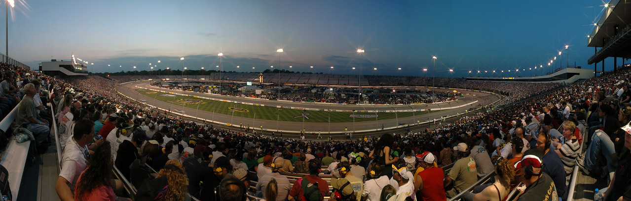 Panoramic photo taken from the Commonwealth section during the Lipton Tea 250 at Richmond International Raceway taken with a Nikon D70 and a 17-55mm f2.8 with a star filter. 13 photos stitched together with Photoshop CS3.