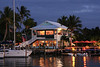 Marsh Harbour Inn<br /> <br /> This photo was taken just as the sun was setting in Marsh Harbour, Abacos Bahamas.  This is home for the Moorings boat fleet which we chartered for our six day sailing adventure.