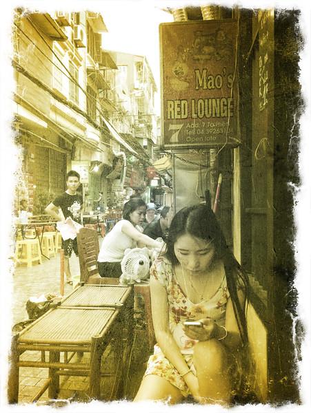 Bar maid in Hanoi's old quarter