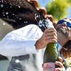Groom opening champagne at Villa Playa Marias.