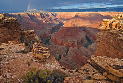 Marble Bend Bow. A rainbow from a morning rain spans across Marble Canyon at Tatahatso Point.
