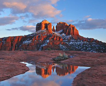 Cathedral Reflections After a late winter snow, Cathedral Rock is reflected in a pool of water on the red rocks.