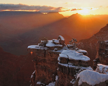 Mather Rays. Beams of morning sunlight enter the Grand Canyon and light icicles hanging off a rock cap near Mather Point.