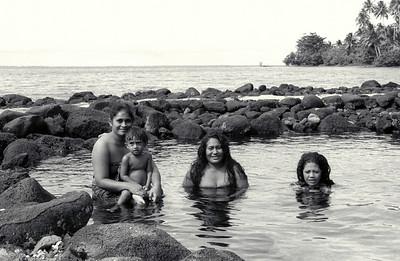 Women in a seaside pond, Western Samoa