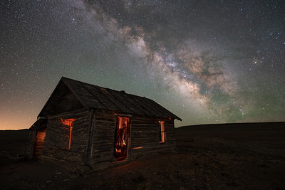 Rancher's cabin, South Park, CO.  This is a combination of one six minute exposure using a star tracking device (sky) with one six minute exposure without a star tracker (foreground).