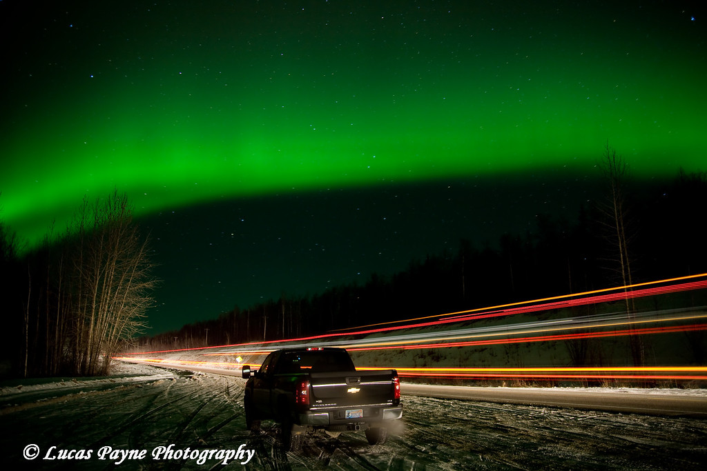 The aurora dancing over my truck along the Parks Highway in Alaska. <br /> (The streak of lights was from a passing semi during my exposure. It also helped to light up my truck and the surrounding area.)<br /> October 28, 2008