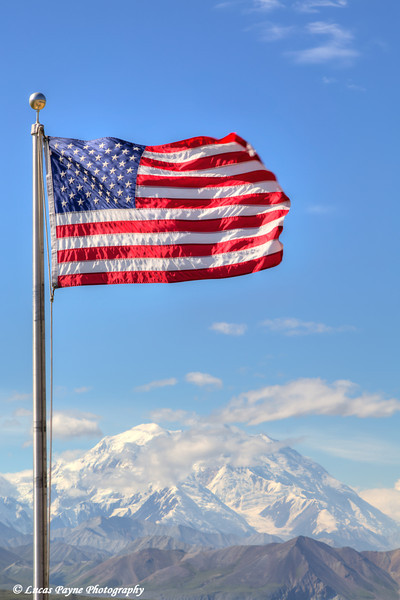 An American Flag flying over the Eielson Visitor Center with Denali (Mt. McKinley) in the background, Denali National Park and Preserve.<br /> <br /> August 02, 2013
