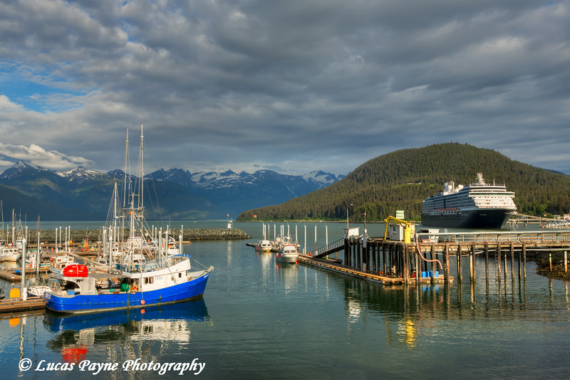 The small boat harbor and Holland America Cruise Ship Oosterdam docked at the Port of Haines, Southeast Alaska.<br /> <br /> July 02, 2014