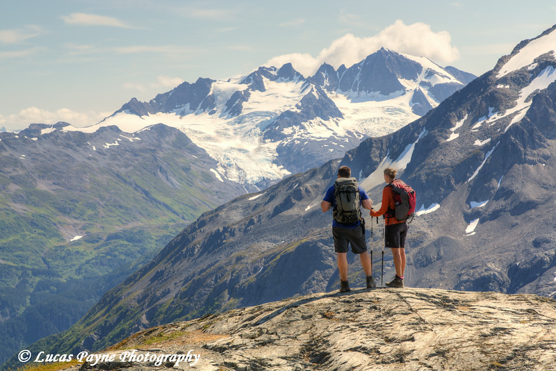 Man and woman enjoying the view  from the Harding Icefield Trail near Seward, Kenai Fjords National Park, Kenai Peninsula, Southcentral Alaska. <br /> <br /> August 02, 2014
