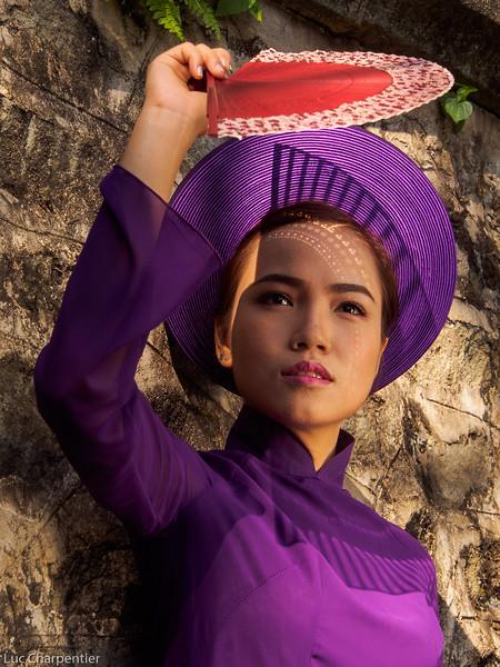 Young woman in purple ao dai