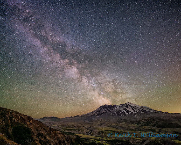 Milky Way, erupting from Mount Saint Helens.  This image is the composite of two images (sky and landscape).  The milky way really did appear in this orientation over Mount Saint Helens.  A four minute exposure was made of the sky, to bring out the vast number of stars.  A tracking system was used to counter earth's rotation during this exposure time.