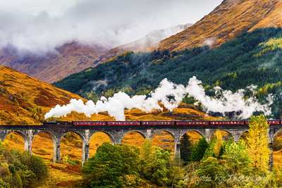 Steam Train Crossing Viaduct