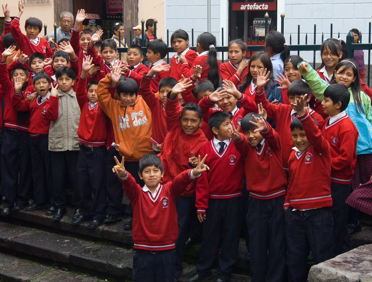 Kids enjoying their moment of fame - the confident peacenik up front is the future president of Ecuador.