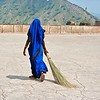 Woman sweeping at Amber Fort.  India 2005.