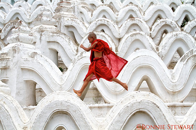 Young monk jumping