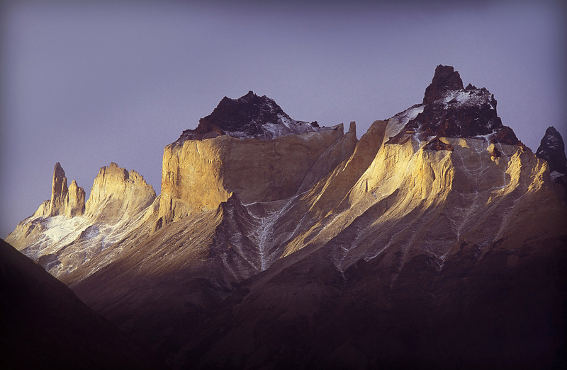 The towers of Paine, Patagonia, Chile <br /> At the end of a circumnavigation of the Towers of Paine, Chile I was hiking in a gulch when I noticed the light glowing on the fringes of the clouds above me. I dropped my pack, grabbed my tripod and ran to the top of a nearby hill just in time to snap four or five shots of the mountains reflecting the ebbing rays of the sun.