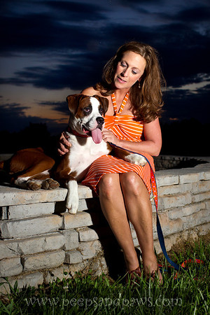 Melvin, an 8 month old Boxer puppy who owns Carrie Dunaway.
