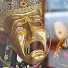 A mask in a store window, New Orleans, LA.