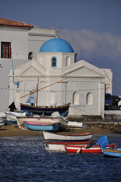 Boats, and a blue-domed church. Mykonos, Greece