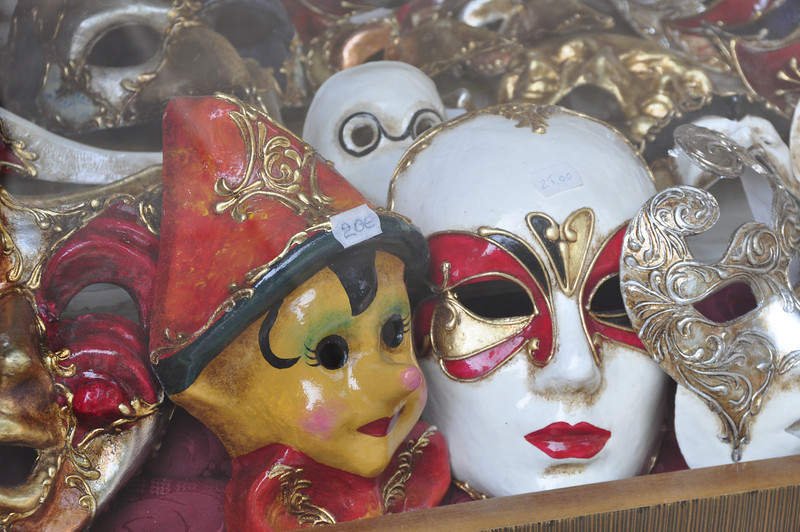 Masks in a shop window, Venice, Italy.